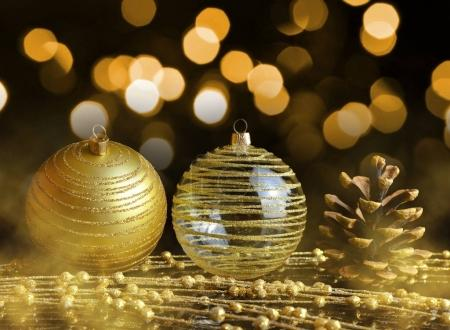 Pine cone and golden Christmas ornaments.