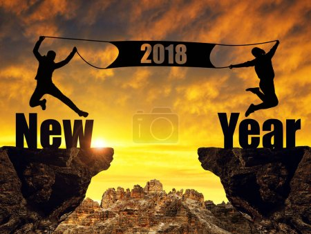 Girls jumping up in the sunset at the celebration of New Year 2018.