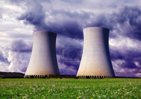 Cooling towers of a nuclear power plant with cloudy sky.