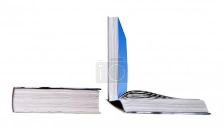 Open and closed book isolated on a white background.