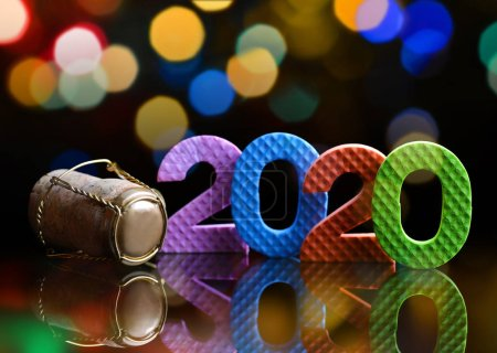 Photo for Cork stopper of champagne with colorful number 2020. Happy New Year concept. - Royalty Free Image