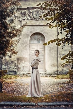 brunette woman in long Victorian dress