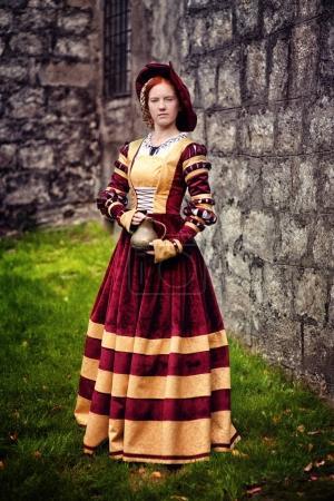 woman in long Victorian dress