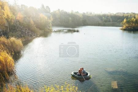 couple swimming on rubber boat