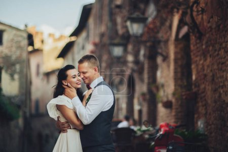 Romantic couple hugging on old town streets