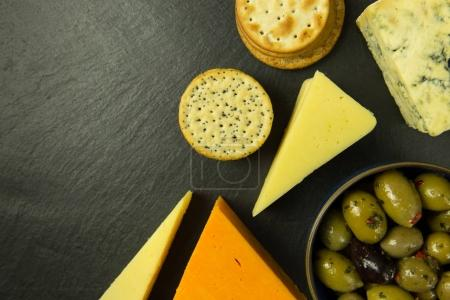 Cheese platter with olives and biscuits