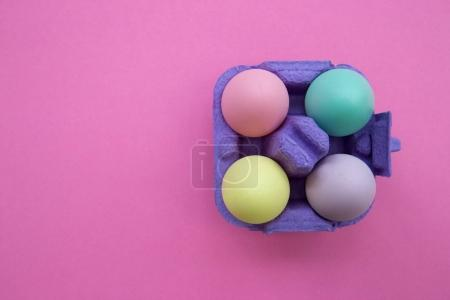 Photo for Colorful Easter Eggs in carton box on pink background - Royalty Free Image