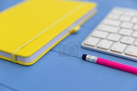 notebook with keyboard and pencil