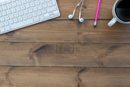 keyboard with music earphones and coffee