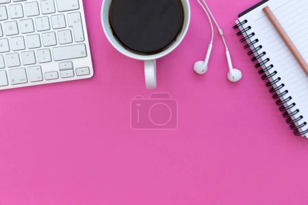 keyboard with coffee and earphones