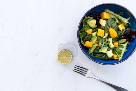 Bowl of mango avocado salad