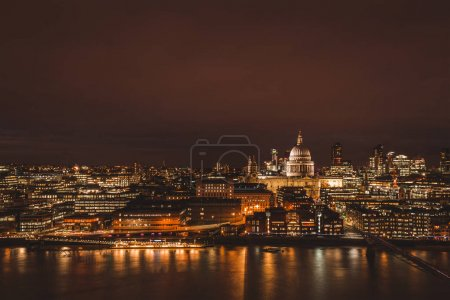 London aerial view of modern city skyline at night on the River Thames