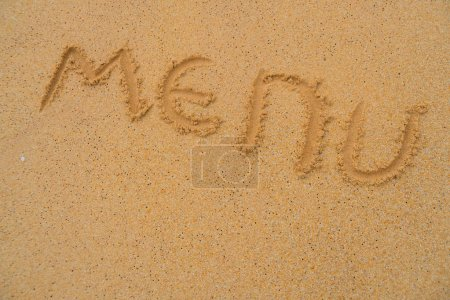 """Photo for The inscription """"Menu"""" on the sand. - Royalty Free Image"""