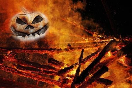 A creepy pumpkin head in the fire. A pumpkin head in the flames