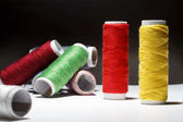 Sewing Quilting Thread, Rainbow colors. on black background with place for your own text