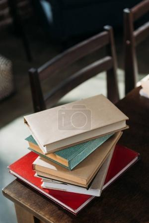 Photo for Close up of heap of books on wooden tabletop with copy space - Royalty Free Image