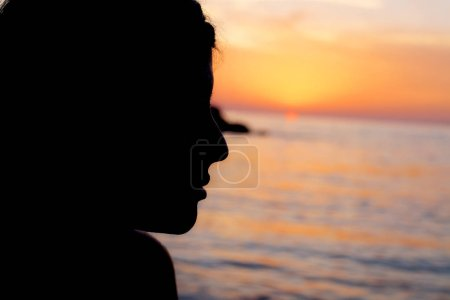 Photo for Gorgeous lady in front of pink sunset - Royalty Free Image