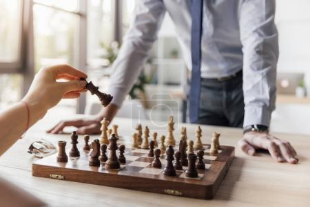 Photo for Partial view of businessman playing chess with colleague in office - Royalty Free Image