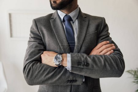 Photo for Partial view of stylish businessman in suit with watch on wrist - Royalty Free Image