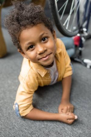 Beautiful african-american boy on floor