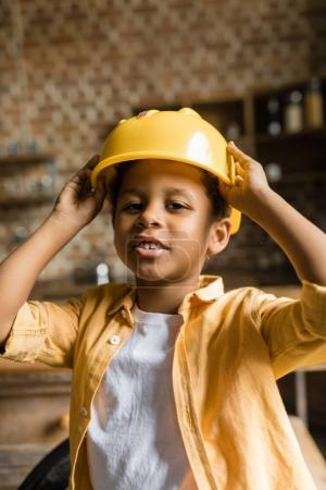 cute african-american boy in hardhat