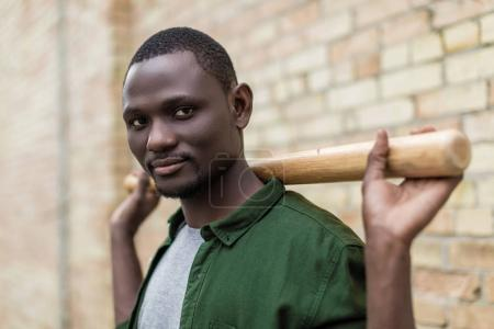 handsome afro man with baseball bat