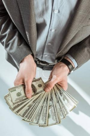 Close-up view of businessman holding money in hands