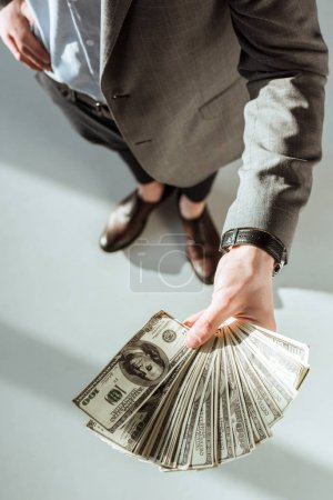 Close-up view of businessman holding money in hand