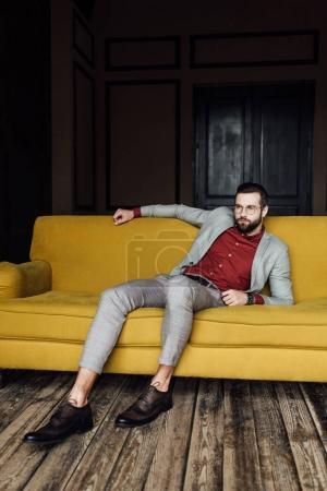 Photo for Handsome elegant man resting on couch - Royalty Free Image