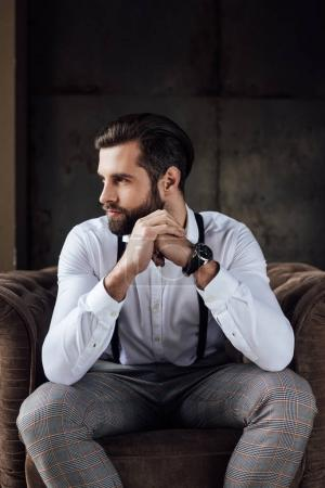 Photo for Handsome stylish thoughtful man sitting in armchair - Royalty Free Image