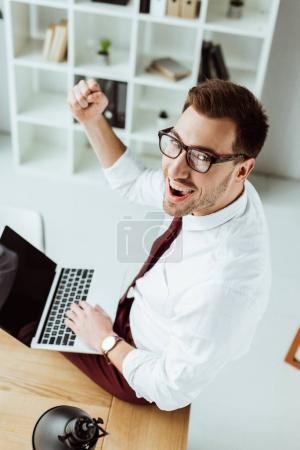 Photo for Successful businessman using laptop at workplace - Royalty Free Image