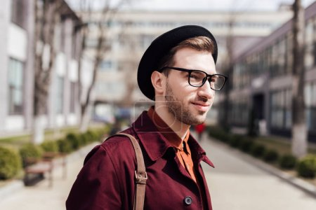 handsome young man in eyeglasses and hat