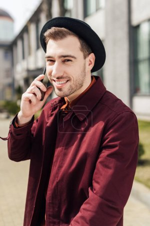handsome smiling man in glasses talking on smartphone