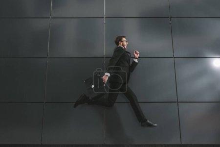 stylish businessman jumping