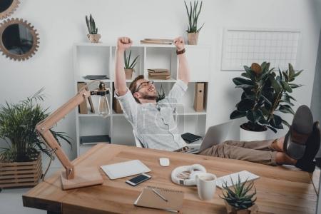 cheerful businessman using laptop