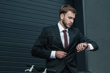 Stylish businessman with bicycle