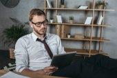 businessman using digital tablet at workplace