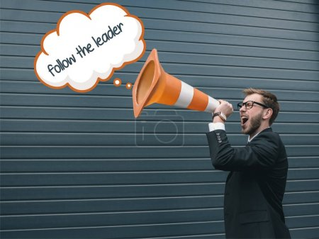 Businessman with traffic cone