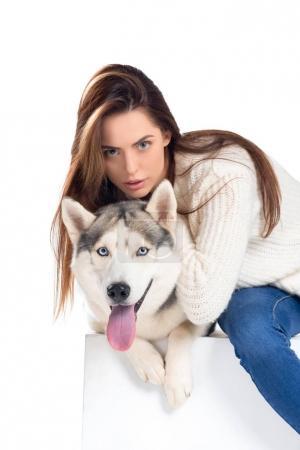beautiful girl hugging husky dog, isolated on white