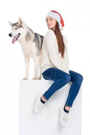 husky dog and beautiful woman in santa hat, isolated on white