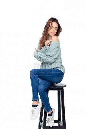 beautiful sensual woman posing on stool, isolated on white