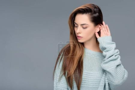 Photo for Beautiful charming girl posing in sweater, isolated on grey - Royalty Free Image