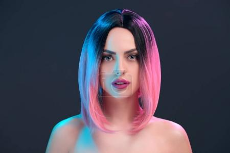 portrait of attractive nude woman in pink wig, isolated on grey