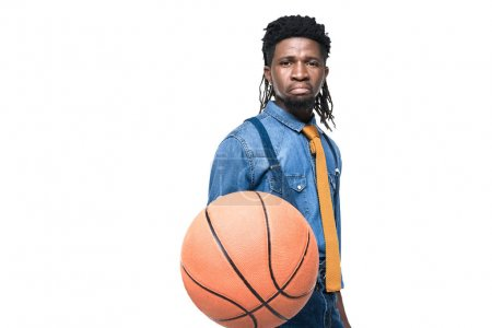 dissatisfied african american man holding basketball ball isolated on white