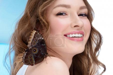 happy young woman with butterfly on shoulder