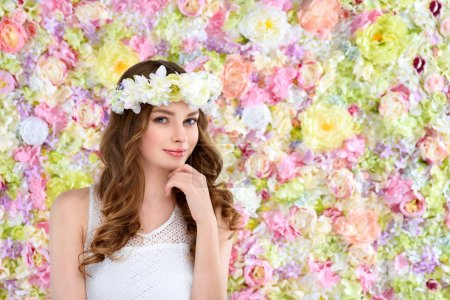 attractive young woman in floral wreath