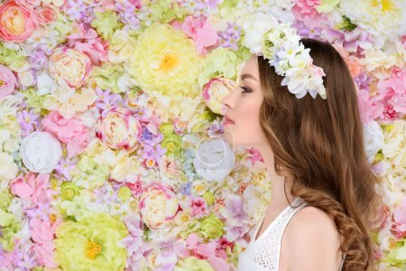 side view of attractive young woman in floral wreath