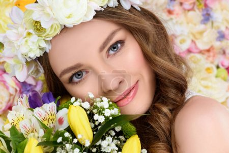 Photo for Close-up portrait of happy young woman with floral wreath and bouquet - Royalty Free Image