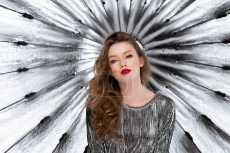 Photo for Attractive young woman against reflective umbrella - Royalty Free Image