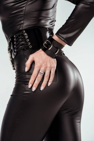 Hand of buttocks of attractive hot girl in catsuit isolated on white